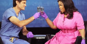 Toasting their success (Dr. Oz and Midas/Oprah), courtesy Deadstate.