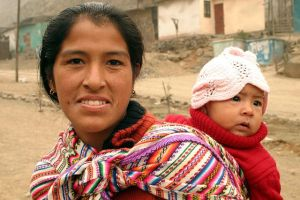 Peruvian mother with child, courtesy Flicker via Ian Riley.